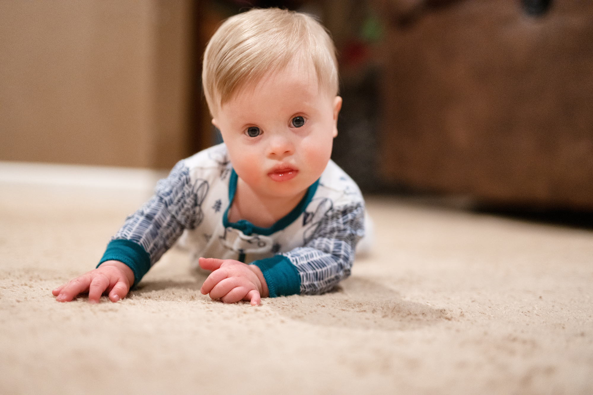 Rohen Carberry laying on carpet floor