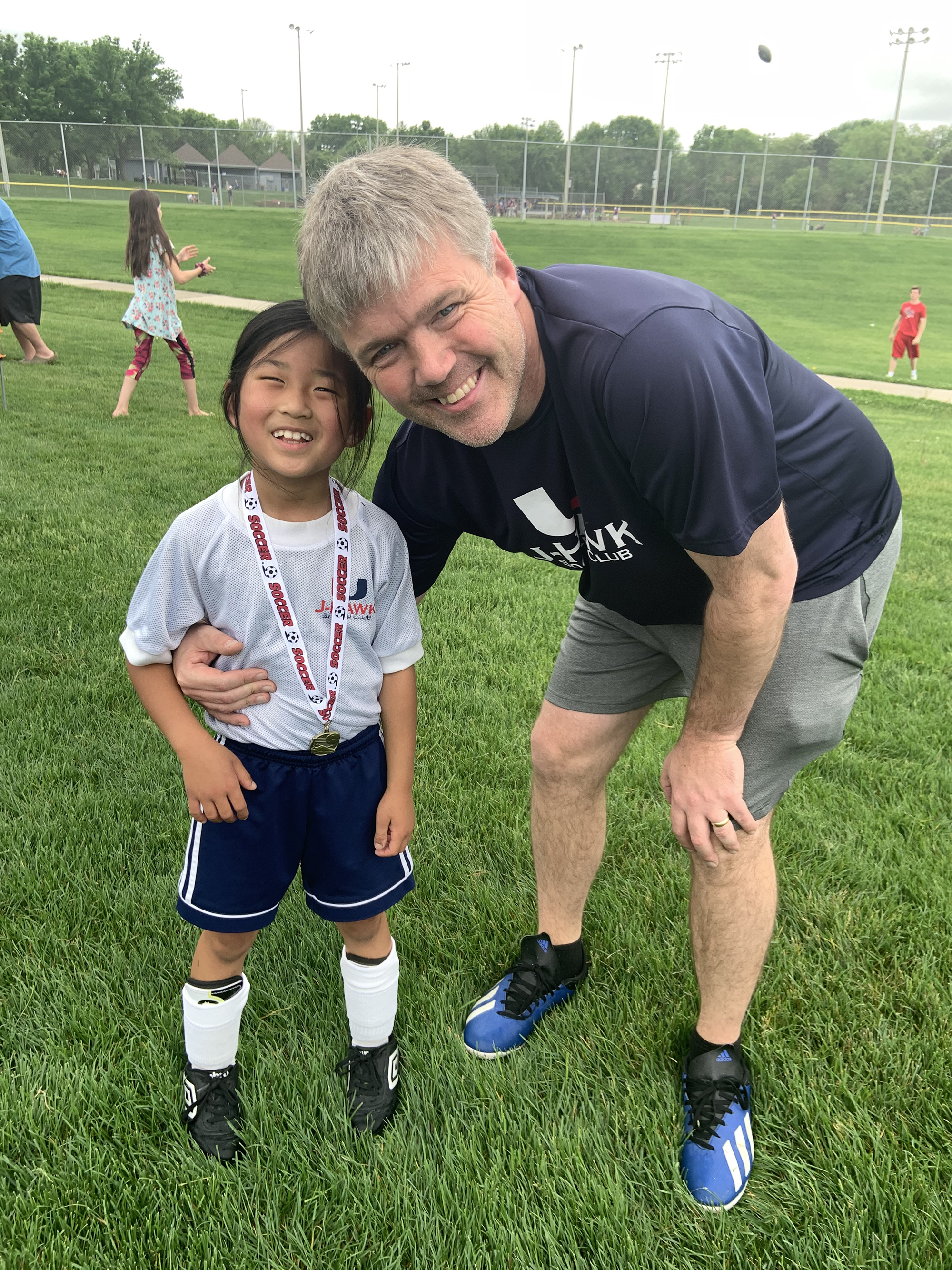 CC and her father at a soccer field