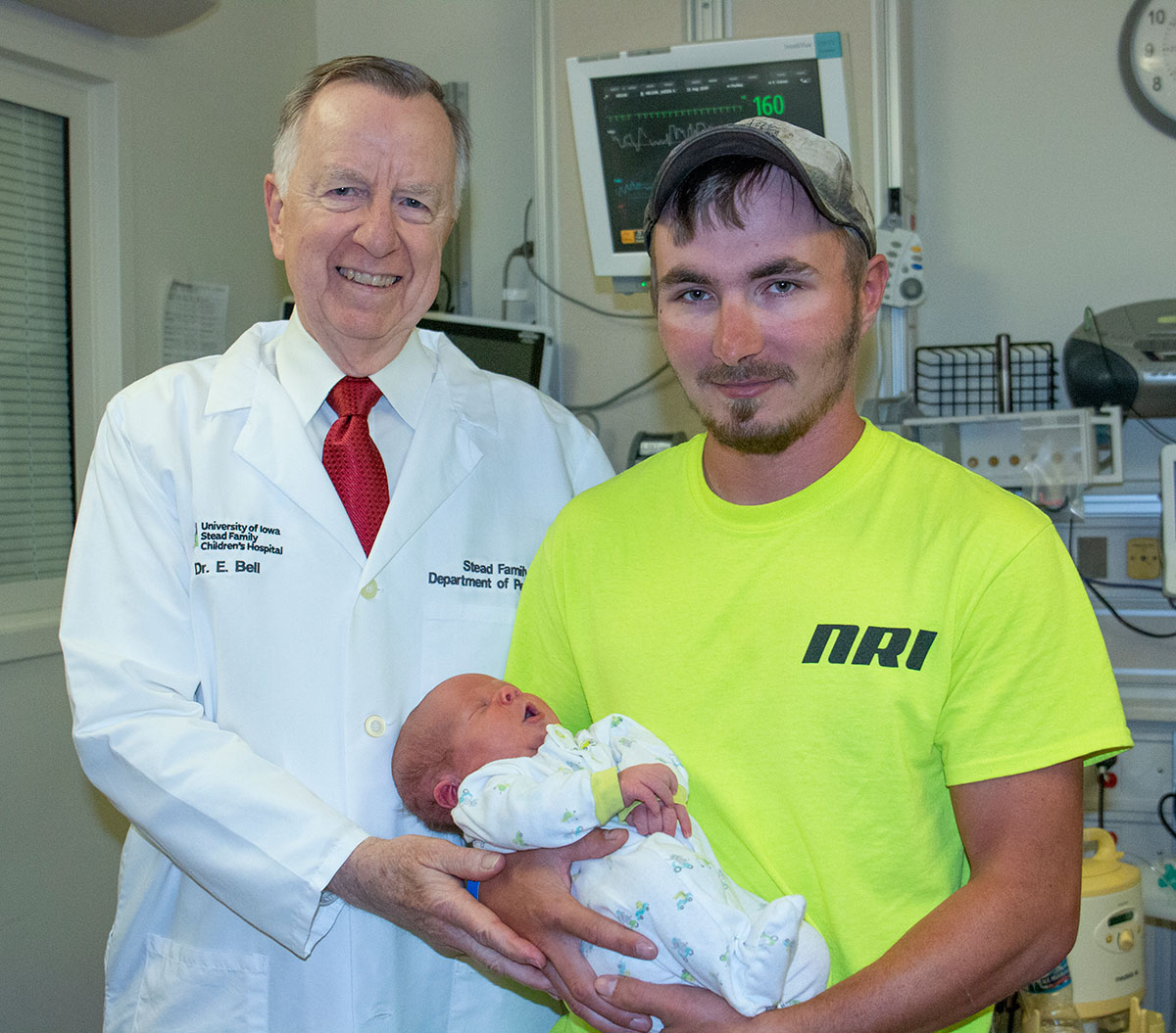 Dr. Bell and Kyle Nelson holding Jaeden Nelson