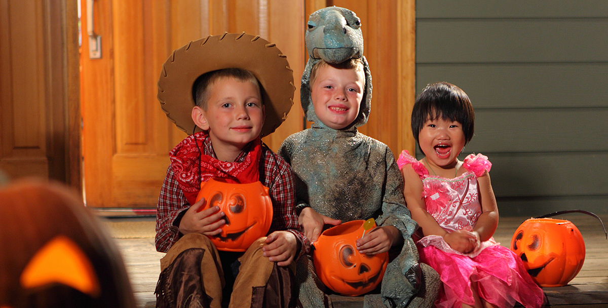 3 children on Halloween night
