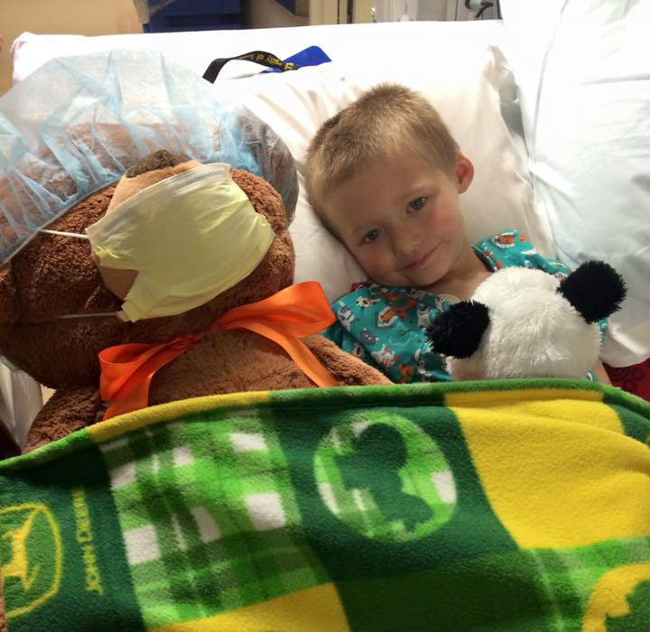 Kale Schmidt resting with his favorite stuffed animals