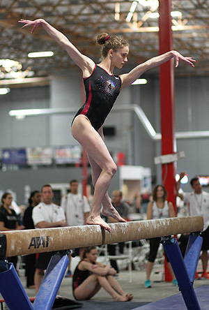 Macall Campbell on a balance beam