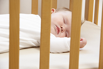Infant sleeping in crib