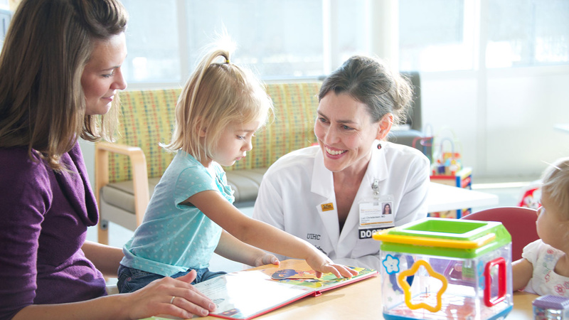 primary care doctor with child and parent, photo
