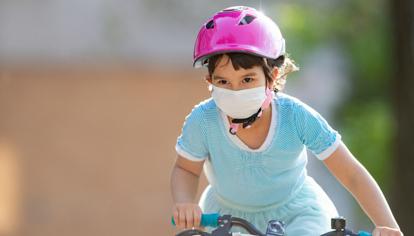 Stock photo of child riding a bike